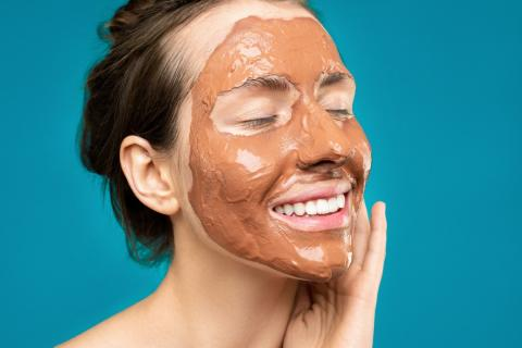 Middle aged woman taking care of skin